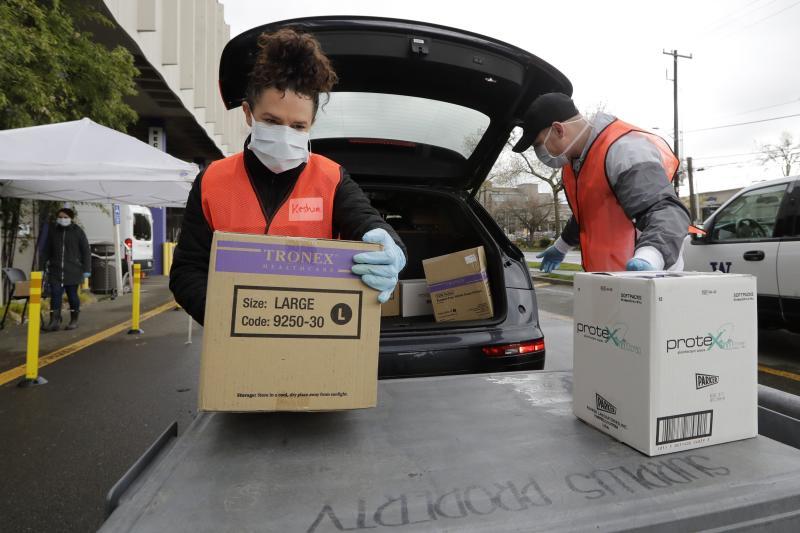 Pabrik-pabrik sarung tangan kesehatan pangkas staf 50% akibat virus