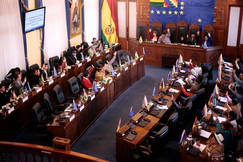 Members of Bolivian Senate approve election law while anti-government protesters in Bolivia lifted street blockades in La Paz