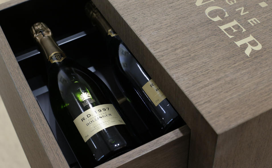 A limited edition 50th anniversary cabinet containing twelve vintages of Bollinger R.D. Champagne is seen at the James Bond movie memorabilia charity auction at Christie's auction house in London, Friday, Sept. 28, 2012. Bollinger was first asked for in a Bond movie by Roger More in 'Live and Let Die' in 1974, and has been used several times since .The champagne is expected to raise some 10-15,000 British pounds ($16,-23,000, euro 12-17,000) with the proceeds going to UNICEF. (AP Photo/Alastair Grant)