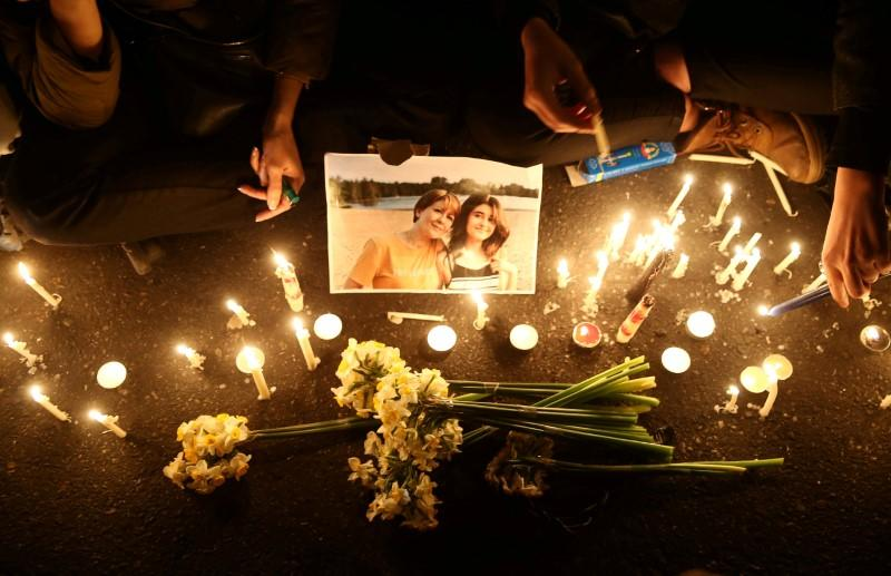 FILE PHOTO: People and families of the victims of the crash of the Boeing 737-800 plane, flight PS 752, light candles as they gather to show their sympathy in Tehran