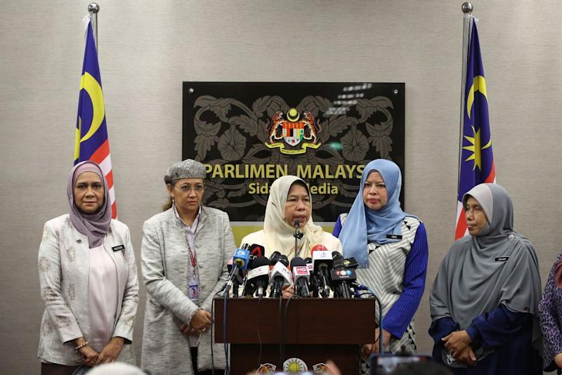 Housing and Local Government Minister Zuraida Kamaruddin (centre) speaks during a press conference at Parliament in Kuala Lumpur July 14, 2020. — Picture by Yusof Mat Isa