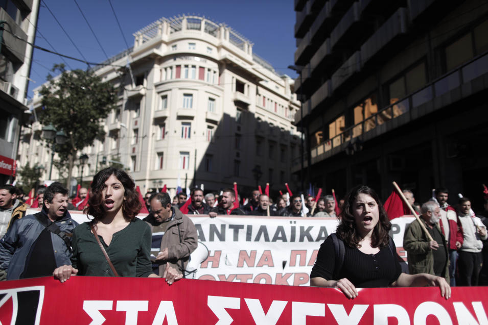 Members of pro-communist union PAME shout slogans during a protest in Athens, Wednesday, Feb. 20, 2013. Thousands of anti-austerity demonstrators took to the streets of Athens on Wednesday as unions staged a general strike to protest the government's spending cuts and tax hikes, which some predict will push unemployment to a stunning 30 percent this year. (AP Photo/Petros Giannakouris)
