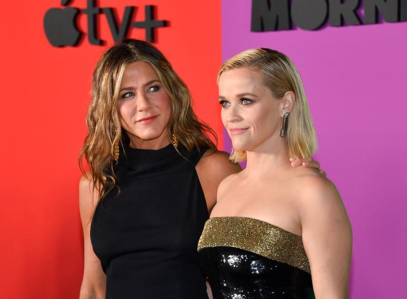 Reese Witherspoon (R) and Jennifer Aniston (L) arrive for Apples The Morning Show global premiere at Lincoln Center- David Geffen Hall on October 28, 2019 in New York. (Photo by ANGELA WEISS / AFP) (Photo by ANGELA WEISS/AFP via Getty Images)
