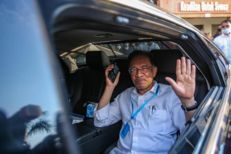 Despite Muhyiddin's role in the so-called 'Sheraton Move' in February, Anwar said he was open to giving the former a place in a PH government. — Picture by Hari Anggara