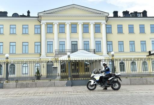 A policeman rides past the presidential palace in the Finnish capital Helsinki, a city which was a hotbed of spies during the Cold War