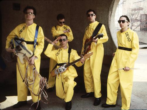 In this 1978 photo taken by Janet Macoska and released by Devo, Inc., the band Devo, from left, Mark Mothersbaugh, Bob Mothersbaugh, kneeling, Jerry Casale, Bob Casale and Alan Myers pose for a photo. Devo spokesman Michael Pilmer confirmed Wednesday, June 26, 2013, that drummer Alan Myers died Monday, June 24, after a battle with brain cancer in Los Angeles. He was 58. (AP Photo/Devo Inc., Janet Macoska) MANDATORY CREDIT
