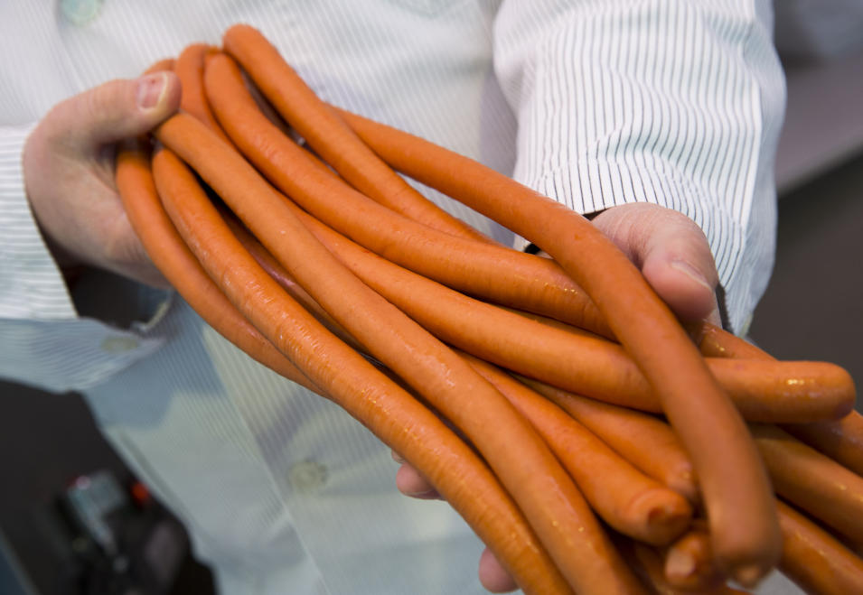 Butcher Norbert Hansel presents his wiener sausages made from horse meat at his sales car at a market in Berlin, Germany, Monday, Feb. 18, 2013. German federal and state agriculture ministers meet in Berlin to discuss the horse meat scandal. (AP Photo/Gero Breloer)