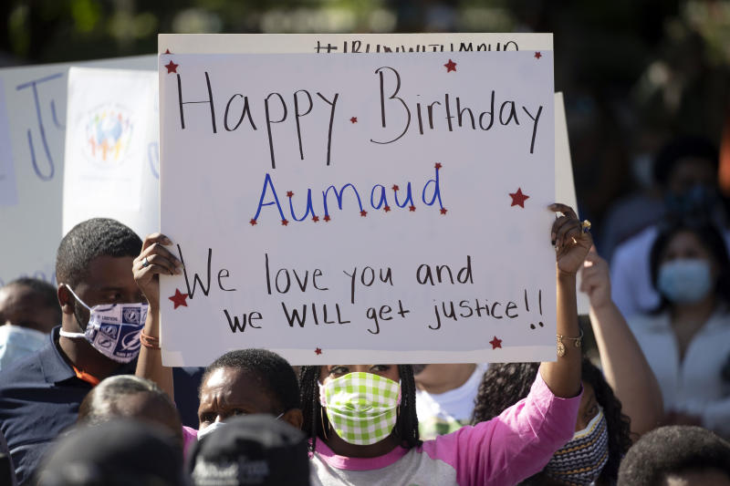 """REMOVES """"UNARMED"""" AND ADDS THAT AUTHORITIES HAVE NOT CONFIRMED THAT ARBERY WAS EITHER ARMED OR UNARMED -  A woman holds a sign during a rally protesting the shooting of Ahmaud Arbery, Friday, May 8, 2020, in Brunswick Ga. Two men have been charged with murder in the February shooting death of Arbery,a black man in his mid-20s, whom they had pursued in a truck after spotting him running in their neighborhood. (AP Photo/John Bazemore)"""
