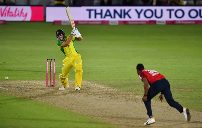 Australia beat England by five wickets to regain T20 top ranking