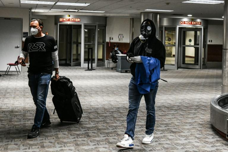 A man wear a gasmask  arrives at Hartsfield-Jackson Atlanta International Airport in Atlanta, on April 23, 2020