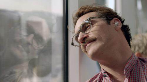 "This image released by Warner Bros. Pictures shows Joaquin Phoenix in a scene from the Spike Jonze film, ""Her."" Phoenix was nominated for a Golden Globe for best actor in a motion picture musical or comedy for his role in the film on Thursday, Dec. 12, 2013. The 71st annual Golden Globes will air on Sunday, Jan. 12. (AP Photo/ Warner Bros. Pictures)"