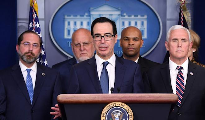 US Treasury Secretary Steven Mnuchin offers reassurances about the economy at the press conference. Photo: AFP
