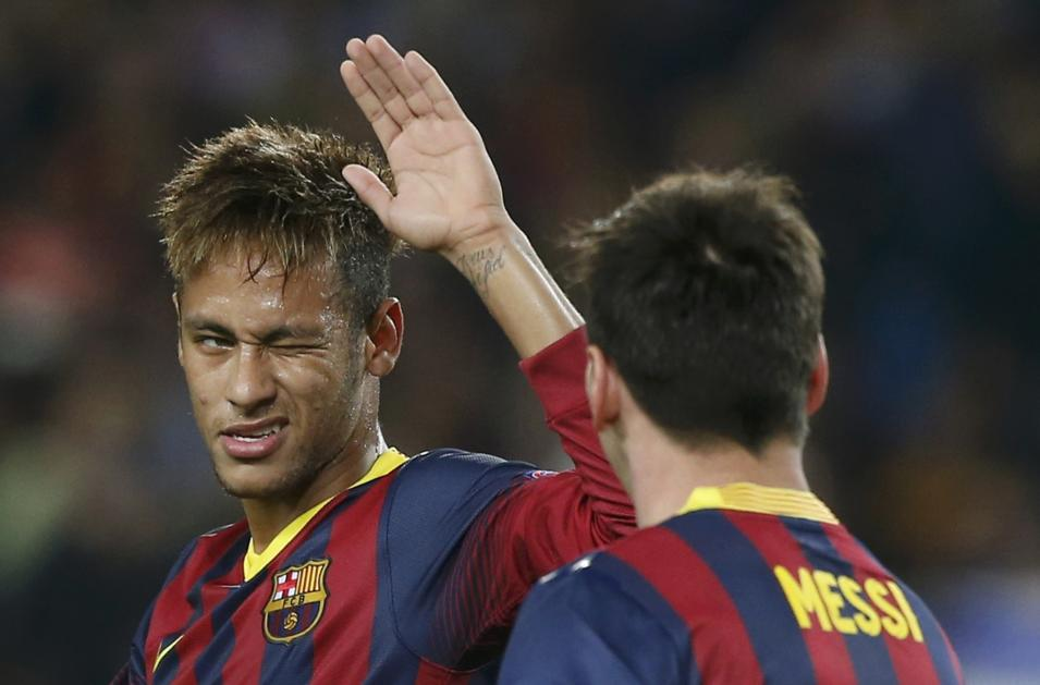 Barcelona's Neymar winks his eye as he congratulates team mate Messi after scoring a penalty against AC Milan during their Champions League soccer match in Barcelona
