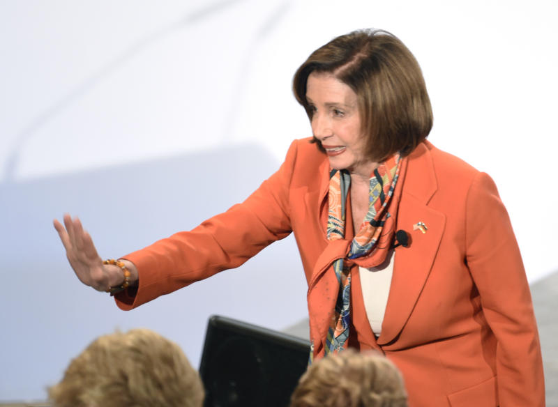 Speaker of the House Nancy Pelosi arrives for the opening session on the first day of the Munich Security Conference in Munich, Germany, Friday, Feb. 14, 2020. (AP Photo/Jens Meyer)b