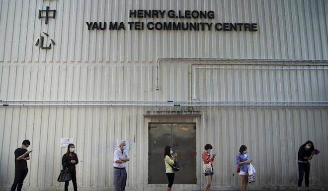 People queue up for virus test at the temporary testing centre in Yau Tsim Mong. Photo: Winson Wong