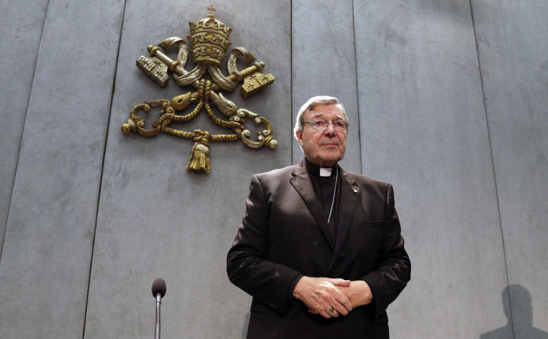FILE - In this Thursday, June 29, 2017 file photo, Cardinal George Pell arrives to make a statement, at the Vatican, Thursday, June 29, 2017. Cardinal George Pell, the former Vatican finance minister who was convicted and then absolved of sexual abuse in his native Australia, is set to publish his prison diary musing on life in solitary confinement, the Psalms, the church, politics and sports. Catholic publisher Ignatius Press told The Associated Press on Saturday the first installment of the 1,000-page diary would likely be published in Spring 2021. (AP Photo/Gregorio Borgia, File)
