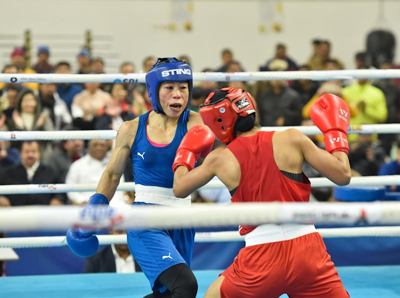 NEW DELHI, INDIA DECEMBER 28: Mary Kom (in blue) and Nikhat Zareen (in red) in action during their 51kg category finals bout of the women's boxing trials for Olympics 2020 qualifiers at Indira Gandhi Indore Stadium, on December 28, 2019 in New Delhi, India. Mary Kom (51kg), six-time world champion, defeated Nikhat Zareen in a split verdict trial bout to make the Indian team for next year's Olympic qualifiers in China. (Photo by Sanjeev Verma/Hindustan Times via Getty Images)