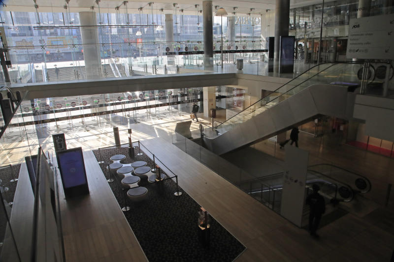 A view of the empty shopping mall at La Defense business district in Paris, Wednesday, March 18, 2020. France is imposing nationwide restrictions on how far from their homes people can go and for what purpose as part of the country's strategy to stop the spread of the new coronavirus. For most people, the new coronavirus causes only mild or moderate symptoms, such as fever and cough. For some, especially older adults and people with existing health problems, it can cause more severe illness, including pneumonia. (AP Photo/Michel Euler)