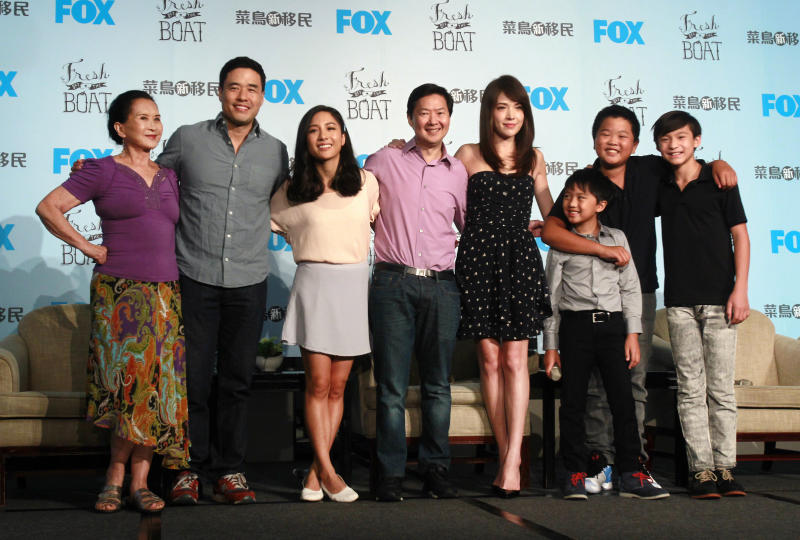 "FILE - In this Friday, Aug. 5, 2016 file photo, actors, from left, Lucille Soong, Randall Park, Constance Wu, Ken Jeong, Ann Hsu, Ian Chen, Hudson Yang and Forrest Wheeler pose for photographers during a media event promoting their television comedy series ""Fresh off the Boat"" in Taipei, Taiwan. The sitcom was the first American TV show to film on location in Taiwan and the first to have a majority of dialogue in Mandarin in one episode. (AP Photo/Chiang Ying-ying)"