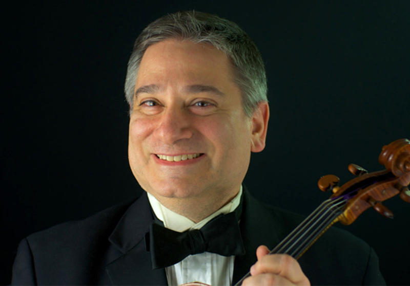 In this undated image, violinist Vincent Lionti poses for a portrait. Lionti played the violin for the Metropolitan Opera Orchestra for 33 seasons. He died April 4 from complications of the coronavirus. He was 60. (Metropolitan Opera via AP)