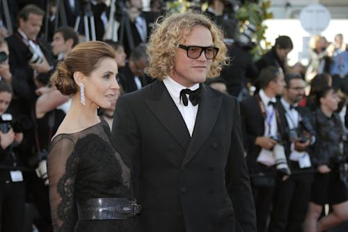 Actress Clotilde Courau, left, and designer Peter Dundas arrive for the screening of the film The Immigrant at the 66th international film festival, in Cannes, southern France, Friday, May 24, 2013. (AP Photo/Lionel Cironneau)
