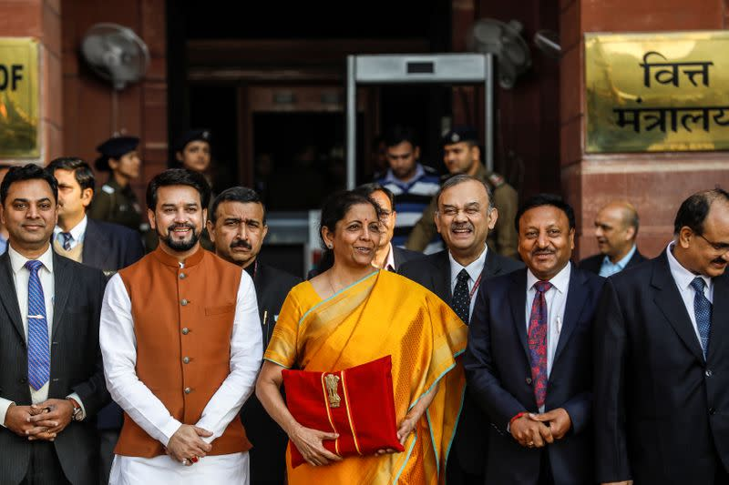 India's Finance Minister Nirmala Sitharaman holds budget papers during a photo opportunity as she leaves her office to present the federal budget in the parliament in New Delhi