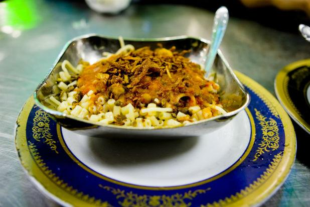 It seems like such a simple dish — rice, brown lentils, chickpeas, and pasta topped off with tangy tomato sauce and caramelized onions — but Koshary (or Koshari) is packed full of rich flavors. While it really is a derivative of the older (meaning rice and lentils) this food is considered to be the national dish of Egypt and is easy to find, from restaurants to food stalls and household kitchens.