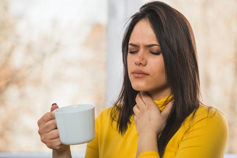 portrait of woman having sore throat problem