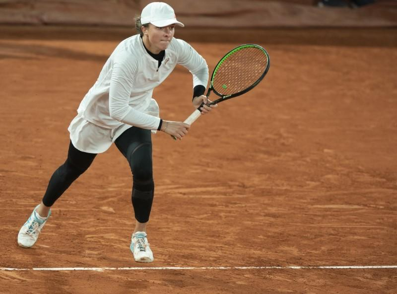 Polish teenager Swiatek powers into French Open semis