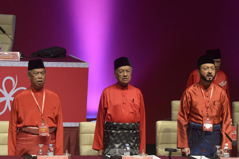 (From left) Tan Sri Muhyiddin Yassin, Tun Dr Mahathir Mohamad and Datuk Seri Mukhriz Mahathir attend Bersatu's second annual general meeting at the Putrajaya International Convention Centre in Putrajaya December 29, 2018. ― Picture by Mukhriz Hazim