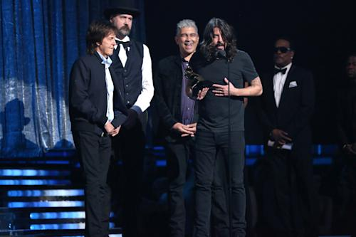 "Paul McCartney, left, and Dave Grohl, right, accept the award for best rock song for ""Cut Me Some Slack"" at the 56th annual Grammy Awards at Staples Center on Sunday, Jan. 26, 2014, in Los Angeles. (Photo by Matt Sayles/Invision/AP)"