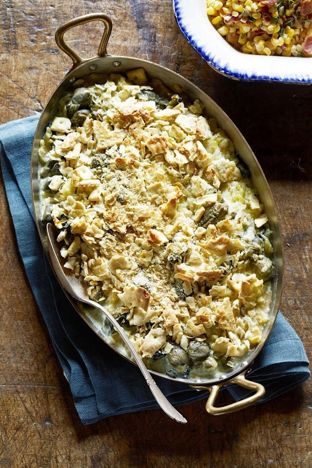 """<p>The trick to keeping this deliciously creamy dish at its best: Put the crushed saltine topping on right before serving. </p><p><strong><a href=""""https://www.countryliving.com/food-drinks/a29132365/scalloped-oysters-recipe/"""">Get the recipe</a>.</strong></p><p><a class=""""body-btn-link"""" href=""""https://www.amazon.com/Lodge-Casserole-Enamel-Handles-Carribbean/dp/B000N4UX4Q?tag=syn-yahoo-20&ascsubtag=%5Bartid%7C10050.g.3726%5Bsrc%7Cyahoo-us"""" target=""""_blank"""">SHOP CASSEROLE PANS</a></p>"""