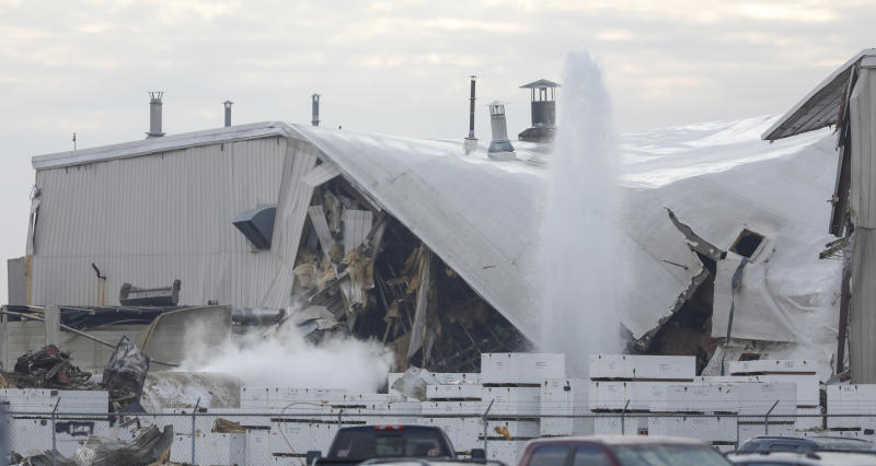 Authorities respond after a partial building collapse at Beechcraft aircraft manufacturing facility in Wichita, Kan., Friday, Dec. 27, 2019. More than a dozen people were injured Friday when a nitrogen line ruptured at the facility, causing part of the building to collapse, authorities said. (Travis Heying/The Wichita Eagle via AP)