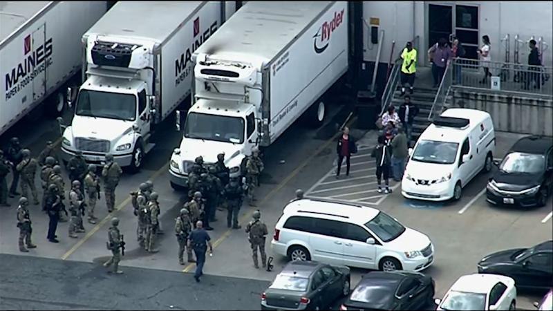 Maryland shooting: Dozens of survivors begin leaving the warehouse as armed officers stand by. Source: AP