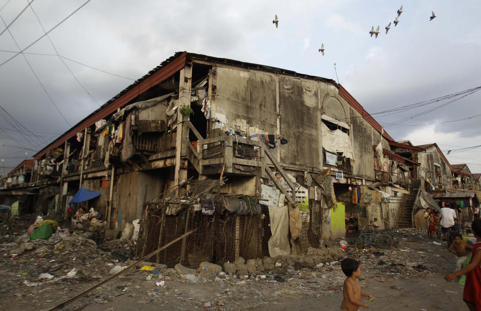 In this photo taken Dec. 4, 2012, the area where Filipino slum dweller Jessa Balote lives at a place called Aroma in Tondo, Manila, Philippines. Balote, who used to tag along with her family as they collect garbage at a nearby dumpsite, is a scholar at Ballet Manila's dance program. As an apprentice, she makes around 7,000 pesos ($170) a month, sometimes double that, from stipend and performance fees. (AP Photo/Aaron Favila)