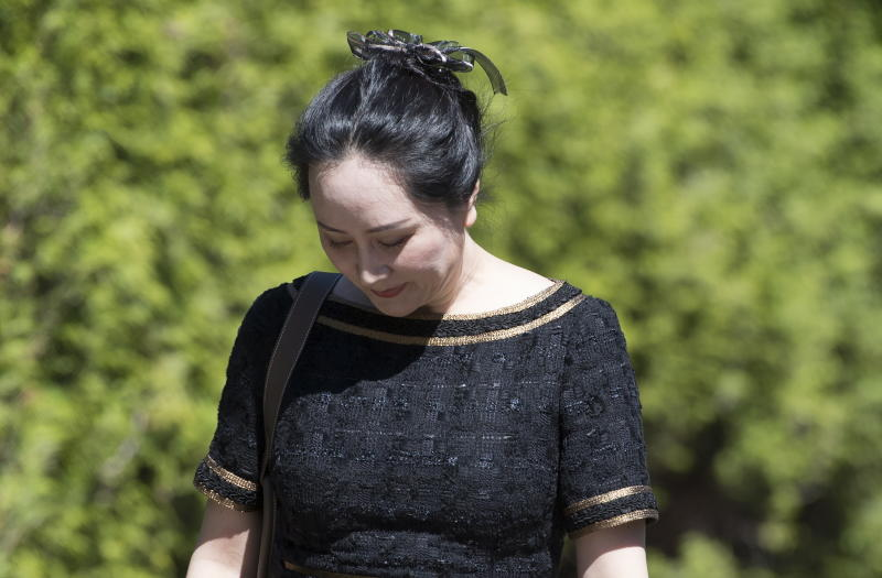 Meng Wanzhou, chief financial officer of Huawei, leaves her home to go to B.C. Supreme Court in Vancouver, British Columbia, Wednesday, May 27, 2020. (Jonathan Hayward/The Canadian Press via AP)
