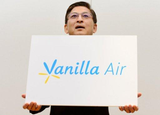 AirAsia Japan President Tomonori Ishii unveils its new brand name 'Vanilla Air' in Tokyo on August 20, 2013. The name was chosen from a list of 200 possibilities