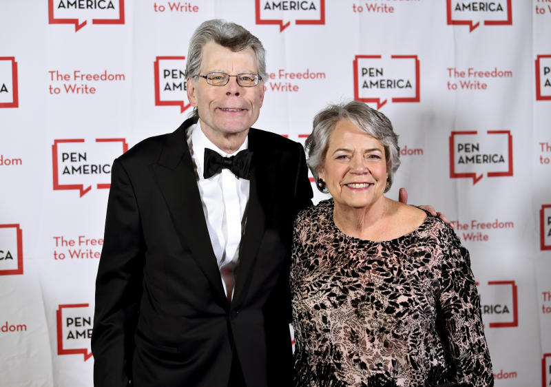 FILE - This May 22, 2018 file photo shows PEN literary service award recipient Stephen King, left, and Simon & Schuster president Carolyn Reidy at the 2018 PEN Literary Gala in New York. Reidy died of a heart attack on Tuesday morning, May 12, 2020. She was 71. Her death was announced by company executive Dennis Eulau. (Photo by Evan Agostini/Invision/AP, File)