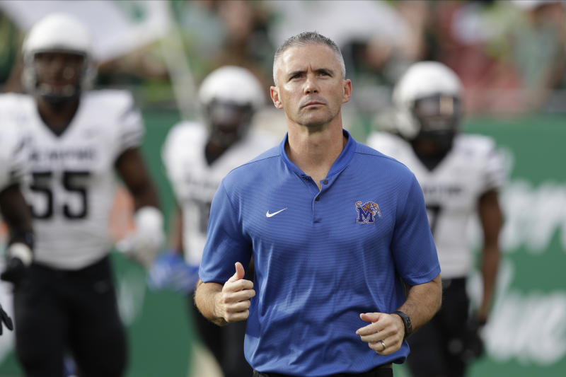 Memphis head coach Mike Norvell runs onto the field during the first half of an NCAA college football game against South Florida Saturday, Nov. 23, 2019, in Tampa, Fla. (AP Photo/Chris O'Meara)