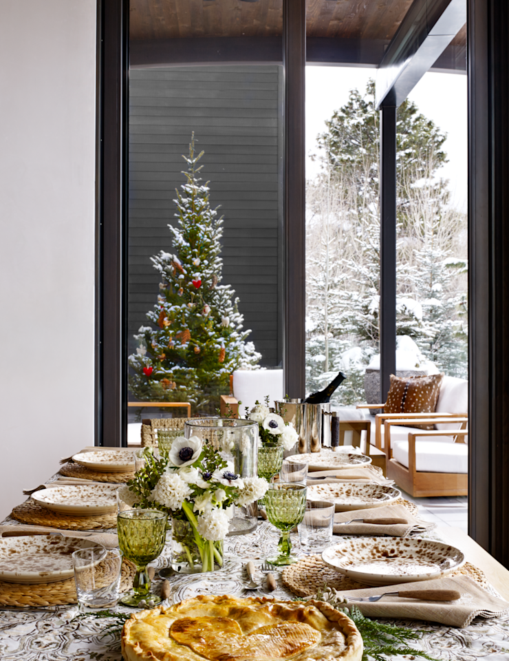 <p>A neutral palette evokes a European holiday escape and keeps the focus on textured materials. Low, scattered floral arrangements in lime green and white are a fresh twist on a traditional holiday color palette.</p>