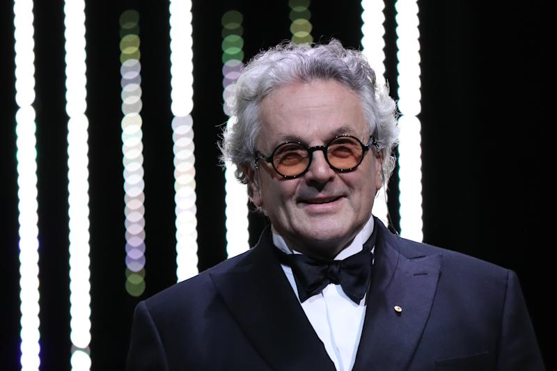 George Miller smiles as he arrives on stage on May 22, 2016 during the closing ceremony of the 69th Cannes Film Festival. (Credit: Valery Hache/AFP via Getty Images)