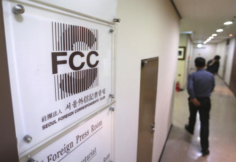 """A man passes by the Seoul Foreign Correspondent's Club office in Seoul, South Korea, Tuesday, March 19, 2019. International journalists' organizations have expressed concern over South Korea's press freedoms after the country's ruling party singled out a Bloomberg reporter over what it claimed was a """"borderline treacherous"""" article insulting President Moon Jae-in, resulting in threats to the reporter's safety. (AP Photo/Ahn Young-joon)"""