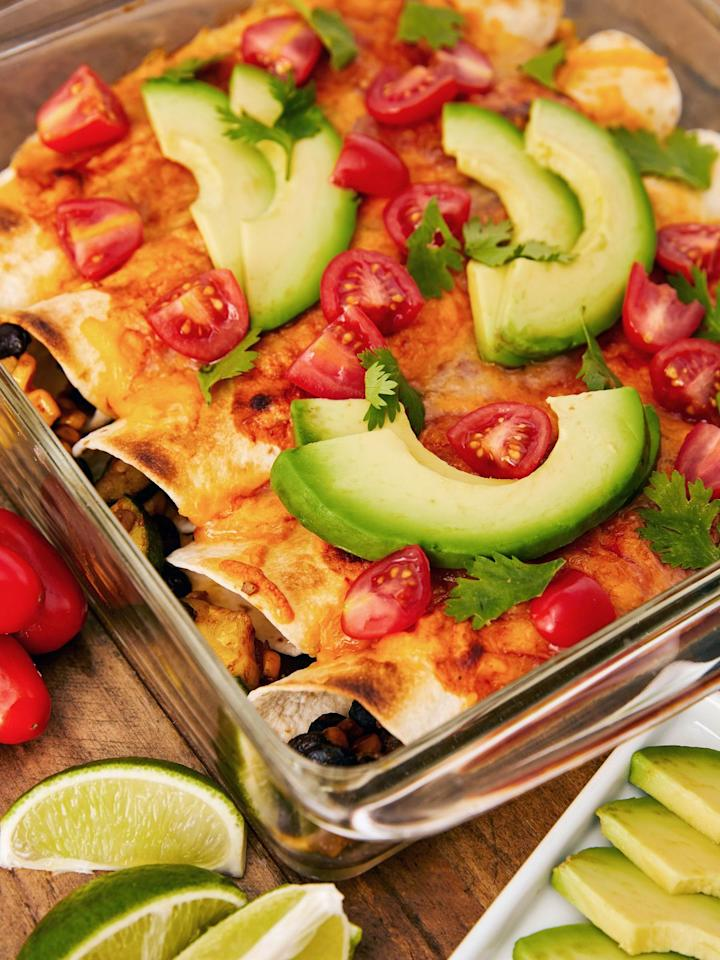 """<p>The definition of a healthy and hearty meal. </p><p>Get the recipe from <a href=""""https://www.delish.com/cooking/recipe-ideas/a23573506/vegetarian-enchiladas-recipe/"""" target=""""_blank"""">Delish</a>. </p>"""