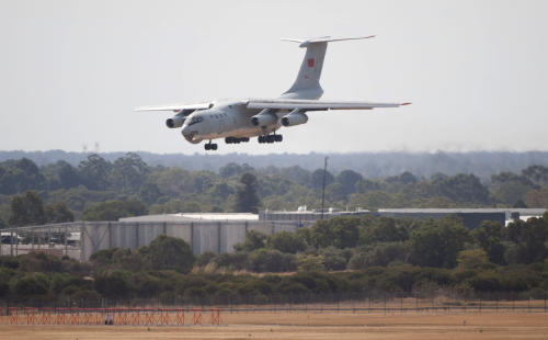 In this photo released by China's Xinhua news agency, a Chinese IL-76 plane searching for the missing Malaysia Airlines Flight MH370 returns to Perth airport, Australia after a hunting sortie, Monday, March 24, 2014. A Chinese plane on Monday spotted two white, square-shaped objects in an area identified by satellite imagery as containing possible debris from the missing Malaysian airliner, while the United States separately prepared to send a specialized device that can locate black boxes. The crew aboard an IL-76 plane sighted the object in the southern Indian Ocean and reported the coordinates to the Australian command center, which is coordinating the multinational search, as well as the Chinese icebreaker Snow Dragon, which is en route to the area, China's Xinhua News Agency reported. (AP Photo/Xinhua, Lui Siu Wai) NO SALES