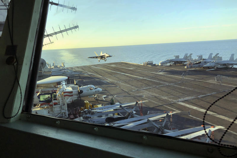 The view as Marine Gen. Frank McKenzie, top U.S. commander for the Middle East, watches from the bridge as an F/A 18 fighter jet lands on the USS Harry S. Truman, Saturday, Feb. 1, 2020. The aircraft carrier is in the North Arabian Sea. Nearly a month after Iran launched a rare direct military attack against United States forces in Iraq, an uneasy quiet has settled across the region. Watching fighter jets roar off the flight deck of the USS Harry S. Truman, the top U.S. commander for the Middle East believes he is surrounded by one of the reasons that Iran has dialed back it's combat stance, at least for now. He says the presence of an aircraft carrier make a potential adversary think twice about war.  But he and other commanders on the ship agree that deterrence is hard to measure. (AP Photo/Lolita Baldor)