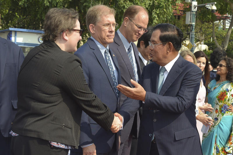 Cambodian Prime Minister Hun Sen, front right, talks in front of U.S. Ambassador to Cambodia W. Patrick Murphy, second from left, during the country's 66th Independence Day from France, at the Independence Monument in Phnom Penh, Cambodia, Saturday, Nov. 9, 2019. The leader of the banned Cambodia National Rescue Party, Sam Rainsy was boarding a fly in Paris for his attempt to return home to challenge his country's longtime autocratic leader as the security inside the country was on high alert and beefed up. (AP Photo/Vithy Soth)