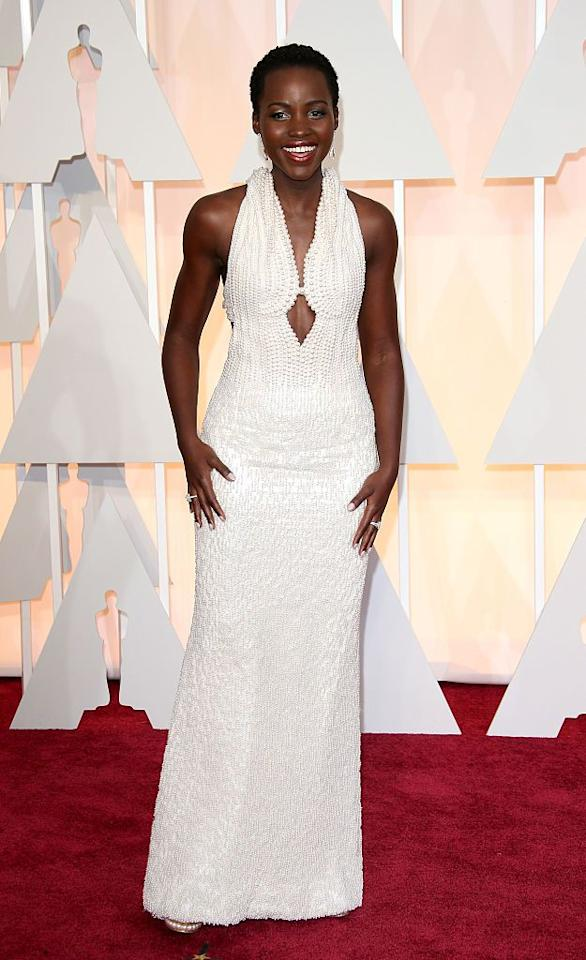 """<p>In 2015, Nyong'o<span class=""""redactor-invisible-space""""></span> looked like a dream in a long, white Calvin Klein gown that featured roughly 6,000 pearls. The showstopper <a href=""""http://fortune.com/2015/02/23/lupita-nyongo-oscar-dress/"""" target=""""_blank"""">was estimated to cost $150,000</a>. </p>"""