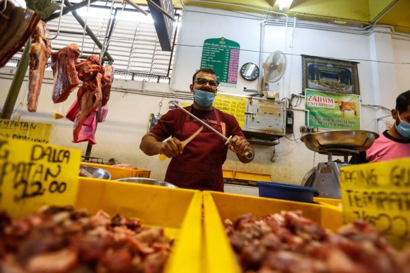 Butcher Abdul Rahman Kachi Mydin gets down to business at the Taman Tun Sardon Wet Market in Penang March 26, 2020. — Sayuti Zainudin