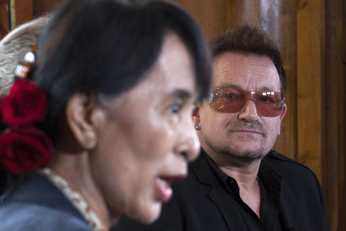 Irish singer and activist Bono, right, looks on as Myanmar's opposition leader Aung San Suu Kyi, left, speaks during a news conference after attending a conference of the Oslo Forum at the Losby Gods resort, about 13 kilometers (8 miles) east of Oslo, Monday, June 18, 2012. The Oslo Forum is an international network of armed conflict mediation practitioners. (AP Photo/Markus Schreiber)