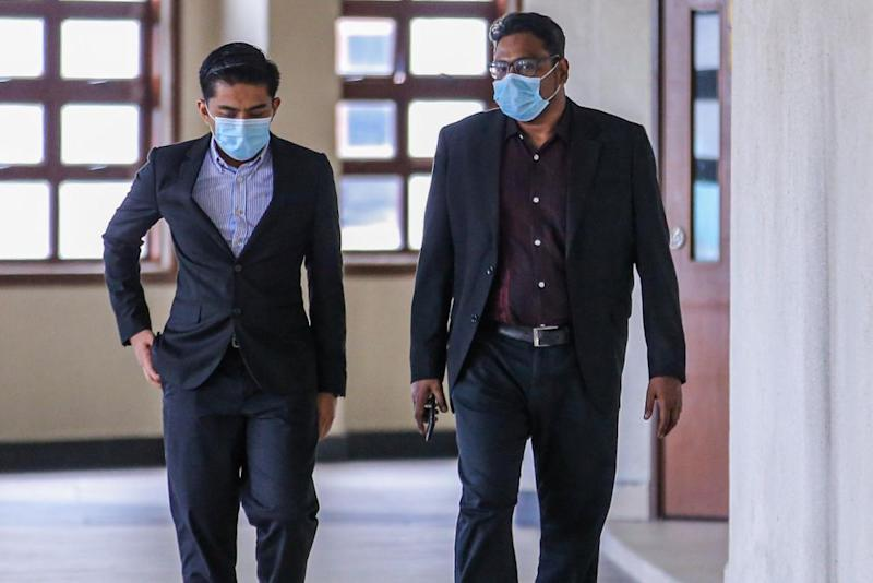 Jepak Holdings Sdn Bhd business partner Rayyan Radzwill Abdullah (right) is pictured at the Kuala Lumpur High Court on July 15, 2020. — Picture by Hari Anggara